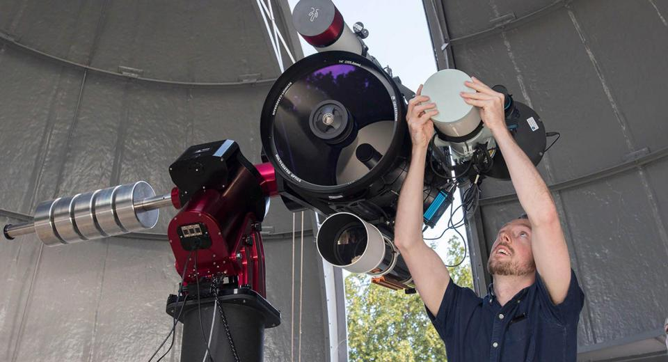 Brendan Owens prepares the new Annie Maunder Astrographic Telescope at the Royal Observatory Greenwich