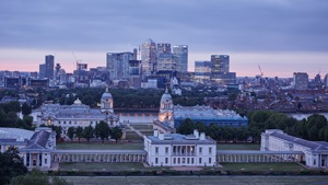 View of Royal Museums Greenwich and canary wharf at dusk