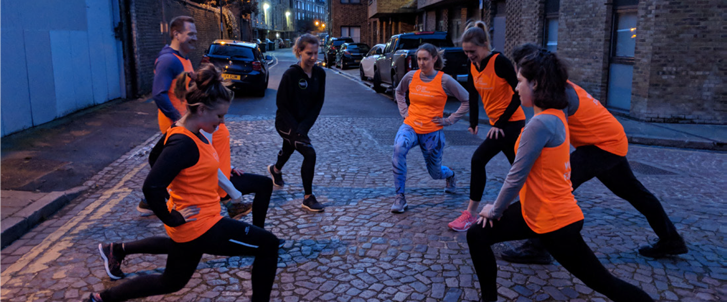 Runners in orange tops training together