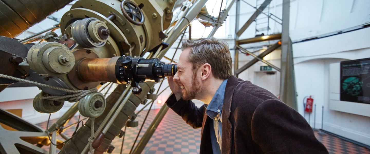 Royal Observatory astronomer looking through telescope