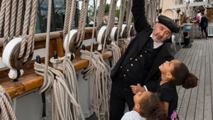 Captain Woodget and children with ropes on board Cutty Sark